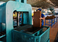 Worker working at rubber processing factory. BINH PHUOC, VIET NAM- MAY 9. Worker working in rubber factory, they pressure slabs  in package. Binh Phuoc, Viet Nam Stock Images