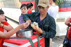 Young Vietnamese man selling Gelato ice cream cone royalty free stock photos