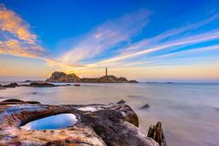 Sunrise on Ke Ga beach in Vietnam. BINH THUAN- VIETNAM: Sunrise over the Ke Ga beach with ancient lighthouse built in year 1890 by French architect. This place Royalty Free Stock Photo