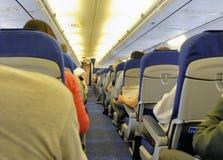 Binnen een vliegtuig stock foto's
