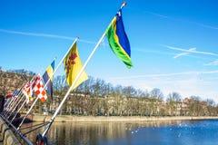 Flags in BinnenHof lake Den Haag. Den Haag lake in front of BinnenHof Royalty Free Stock Images