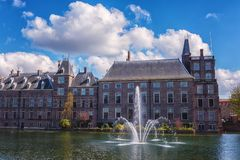 Binnenhof castle Dutch Parliament background with the Hofvijver lake, historical complex, Hague Den Haag, Netherlands. Binnenhof castle Dutch Parliament royalty free stock images
