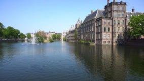 Binnenhof - Dutch Parliament, Holland. Binnenhof - Dutch Parliament with fountain in pond, The Hague at spring with flowers, Holland stock video