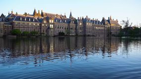 Binnenhof - Dutch Parliament, Holland. Binnenhof - Dutch Parliament with reflections in pond water, The Hague at spring with tulips flowers, Holland stock video