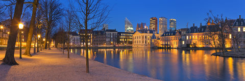 The Binnenhof in The Hague, The Netherlands at night. The Dutch Parliament buildings at the Binnenhof from across the Hofvijver pond in The Hague, The Royalty Free Stock Photography