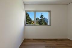 Binnenland, ruimte met parketvloer stock foto