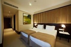 Binnenland van een hotelslaapkamer Royalty-vrije Stock Afbeeldingen