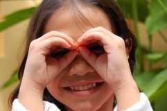 Binocular. A little girl using her hand as binocular royalty free stock images