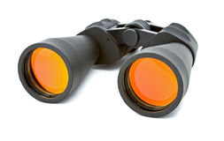 Binocular. Black binocular over white background. Yellow reflections on the lens stock photography