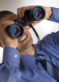 Binocular. Young business men looking through binocular concept stock photography