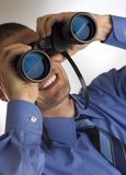 Binocular. Young business men looking through binocular close up royalty free stock photo