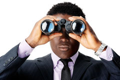 Binocular african man. Serious binocular businessman looking towards camera. african man royalty free stock image