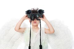 Binocular and angel Stock Photos
