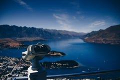 Binocular on balcony above city on coast royalty free stock images