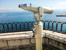 Telescope on view point overlooking the sea. Telescope on Corfu Island, Greece, for public use on a hill overlooking the Mediterranean Sea Royalty Free Stock Photos