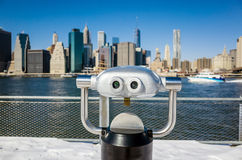 A binocular in Brooklyn Bridge Park view of New York city. Manhattan buildings with the 1 WTC building Stock Image