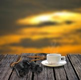 Binocular and coffee cup on table. Adventure concept Stock Images