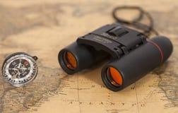 Binocular and compass on map Stock Photo