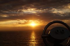 Binocular of a cruise ship. In front the Binocular of a cruise ship in the back the sunrise in the caribbean sea Royalty Free Stock Photography