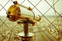 Binocular in Eiffel Tower and view of Paris Stock Image