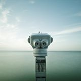 Binocular faced to the ocean Stock Photos