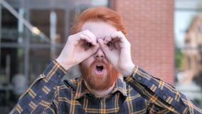 Binocular Gesture by Redhead Beard Young Man stock video footage