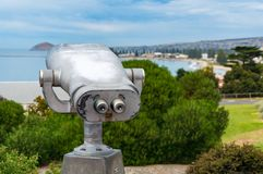 Binocular with harbour view. Travel, explore background Stock Photography