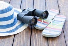Binocular and hat with flip flops Stock Image