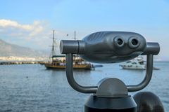 Binocular looks at the ships at sea. stock photo