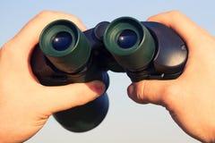 Binocular in mans hands Royalty Free Stock Photo