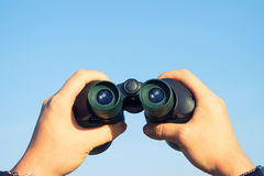 Binocular in mans hands Royalty Free Stock Photos