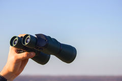 Binocular in mans hands Royalty Free Stock Images