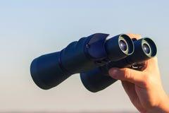 Binocular in mans hands Stock Photography