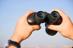 Binocular in mans hands Royalty Free Stock Image