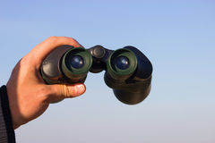 Binocular in mans hands Royalty Free Stock Photography