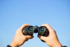 Binocular in mans hands Stock Images