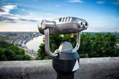 Binocular next to the waterside promenade Royalty Free Stock Image