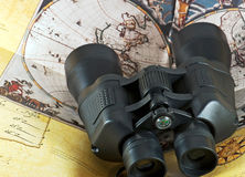 Binocular on old pirate map Royalty Free Stock Photography