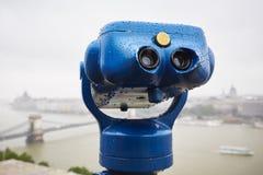 Binocular in the rain Stock Images