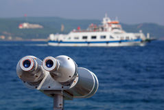Binocular for seeing the far ships. On the sea Stock Image