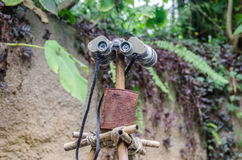 Binocular on a stick in the jungle Stock Images