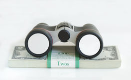 A binocular on the top of a stack of $2 dollar bil. Ls: Your Text is at the Binocular Royalty Free Stock Photography