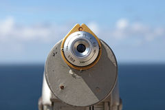 A binocular viewer looking out over blue sky. Royalty Free Stock Images