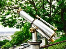 Binocular. Vintage, silver and gold binocular and view over Paris Royalty Free Stock Image