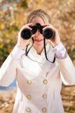 Binocular woman Stock Images
