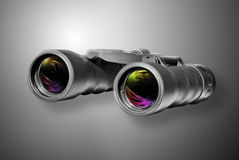 Binoculare su priorità bassa nera immagini stock