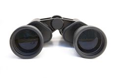 Binoculars. These black binoculars are staring straight at you. On a white background Royalty Free Stock Photos