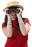 Binoculars. Girl with a straw hat looking at the camera through binoculars Royalty Free Stock Images