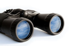 Binoculars. Whith a feflection of a blue sky Stock Images