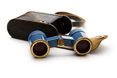 Binoculars. Old blue binoculars on white Royalty Free Stock Photos